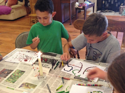 Working on their melted crayon art projects