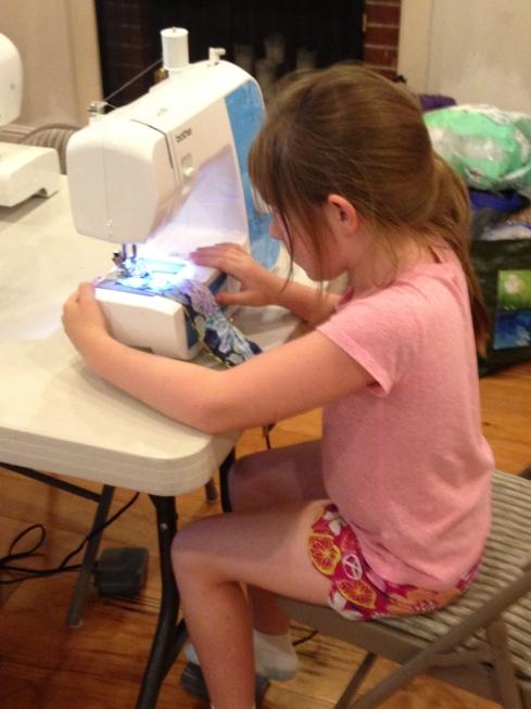 2nd grader sewing.