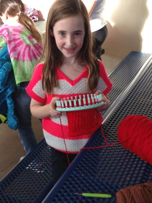 3rd grader rockin' the knitting loom.