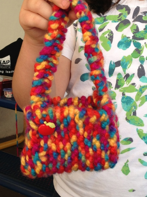 Close up of knitted bag.