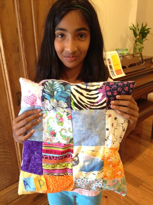 Finished pieced quilted pillow by 3rd grader.