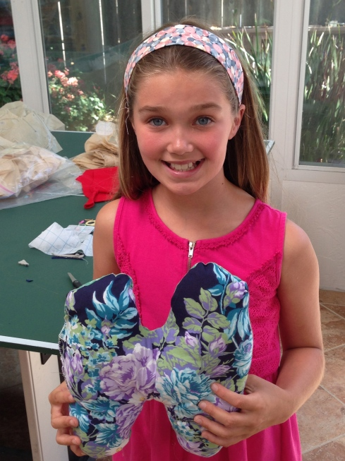 """5th grader letter """"H"""" pillow and a headband."""