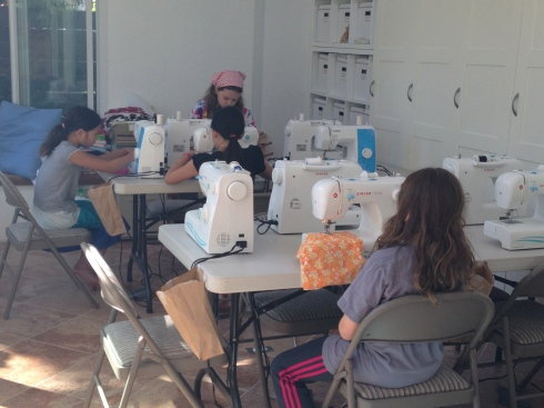 Sewing up their pillows.