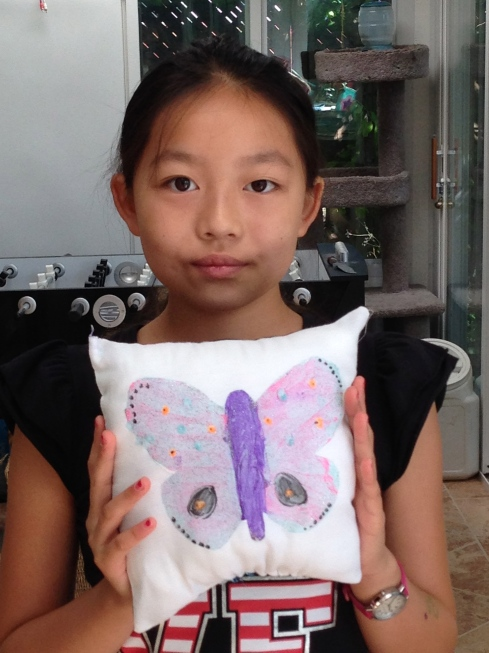 6th grader fabric painted pillow.