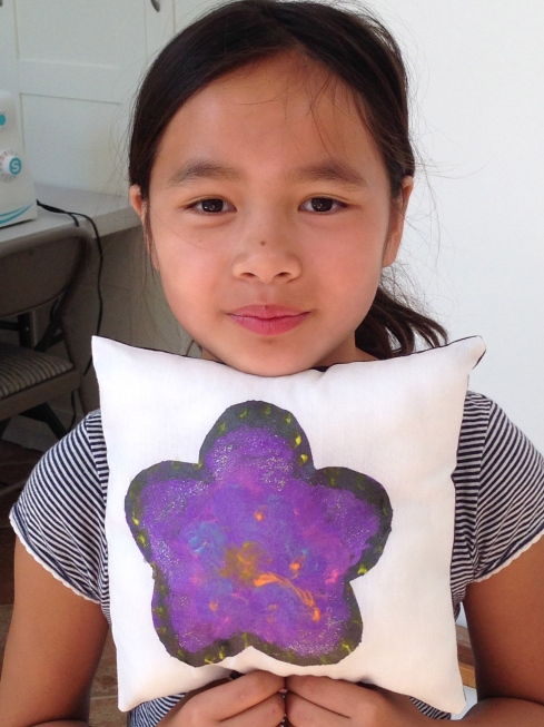 4th grader fabric painted pillow.