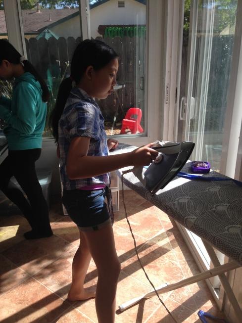 Ironing a waist band.