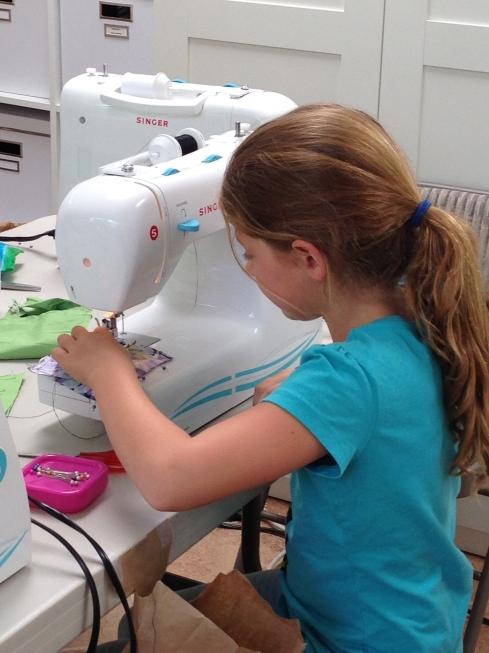 3rd grader sewing.