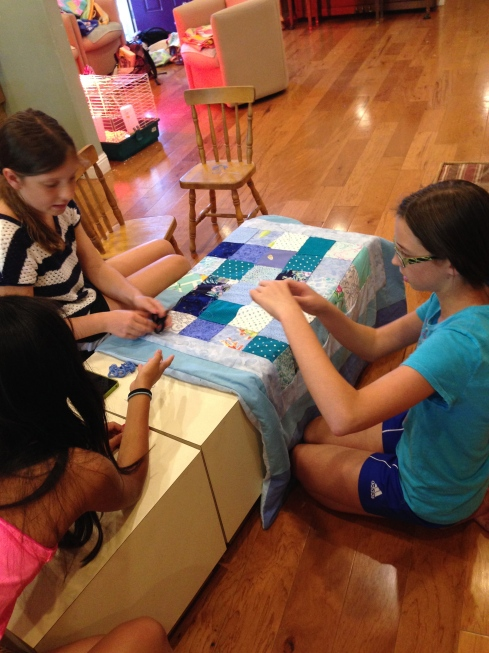 Working together to tie a quilt.