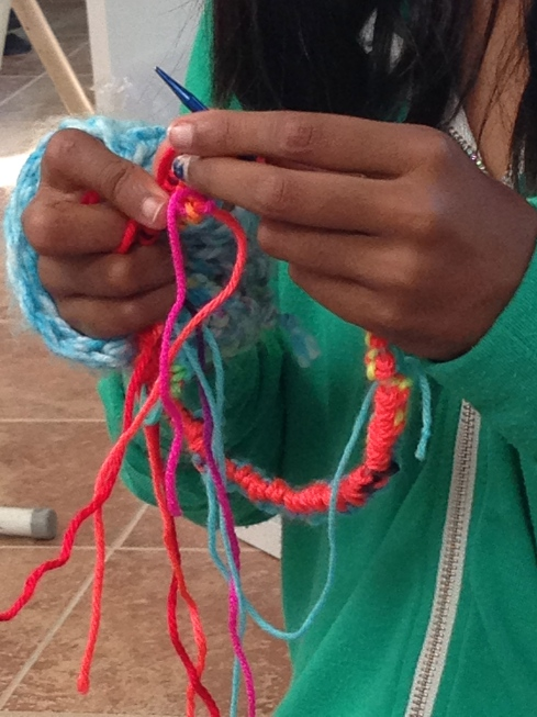 The start of a hat being knit in the round by a 4th grader.