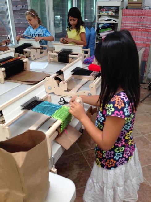 4th grader weaving.