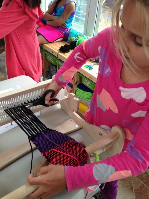 Cutting a project off the loom.