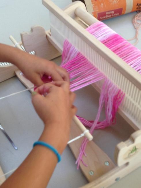 Tying the warp onto the apron stick.