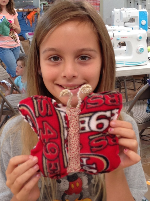 4th grader self-designed butterfly pillow.