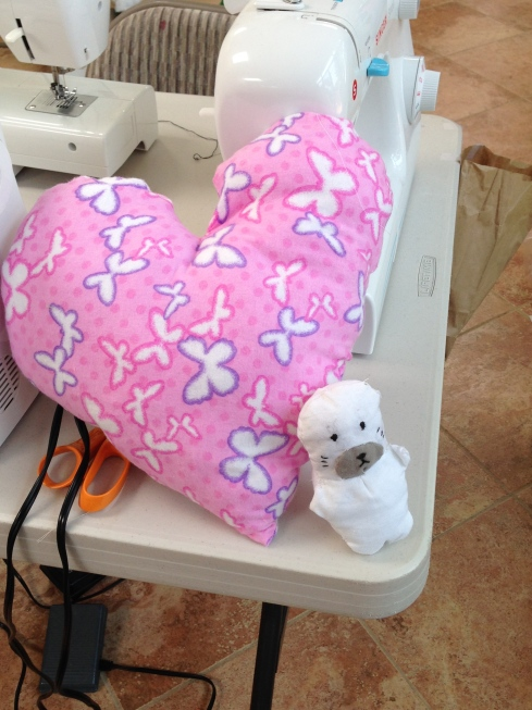 7th grader heart pillow and seal stuffie.