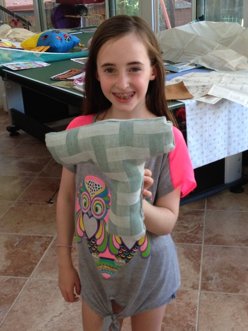 "4th grade ""T"" pillow."