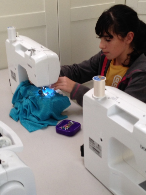 5th grader sewing a knit top.