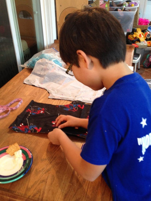 Making shorts for his brother.