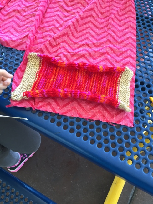 Knitted part of coin purse done!  Measuring for the lining.