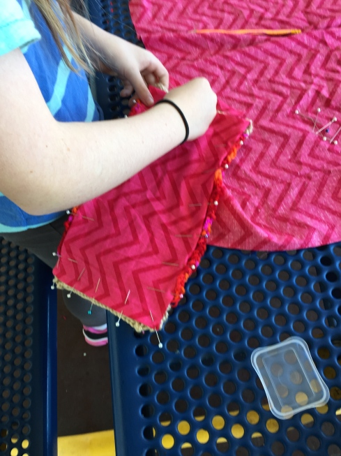 Lining being sewn into the coin purse.