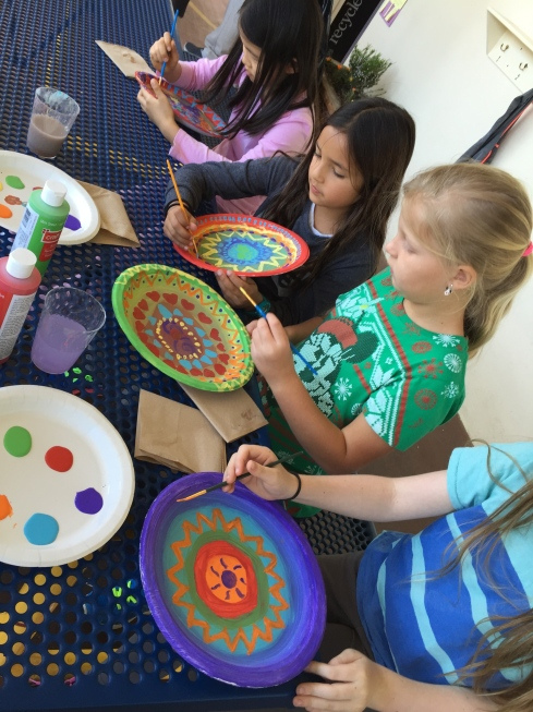 Finishing the painting for our circle weaving.