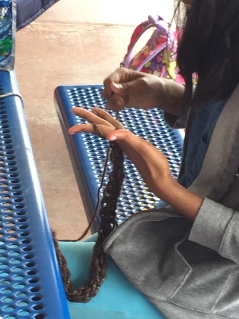 Finger knitting.
