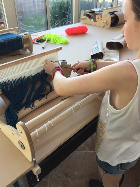 Warping up a loom for her next project.