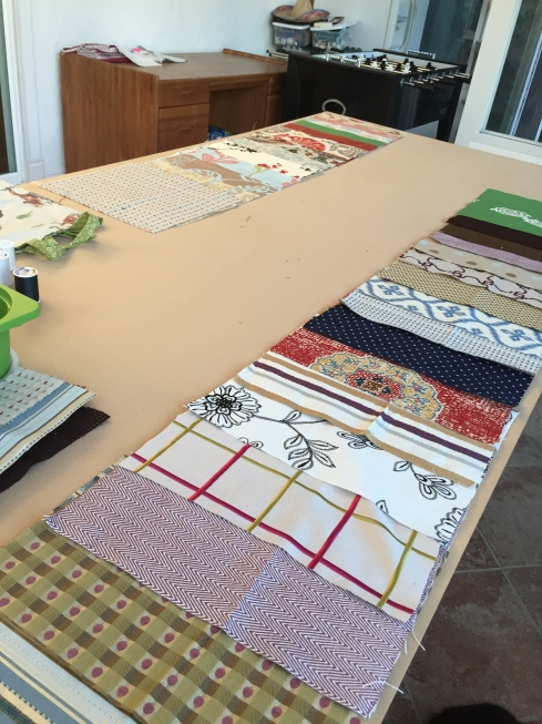 All fabrics cut and placed on our worktable.