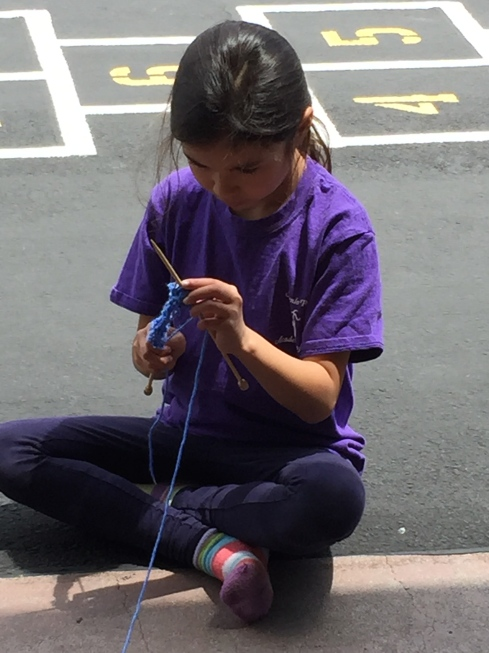 New knitter working hard.