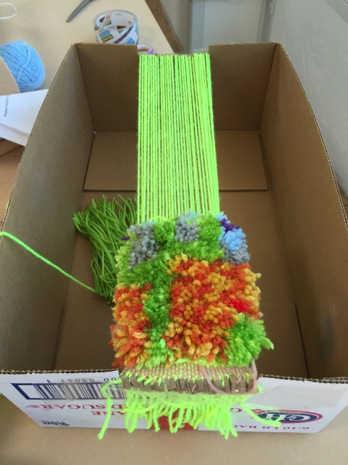 "Rya Knot project almost complete - we made our weaver a ""box loom"" so she could finish at home."