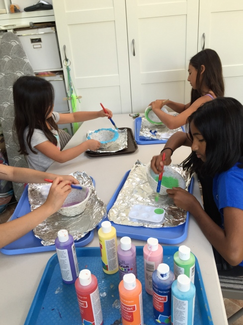 Painting our paper pulp bowls.