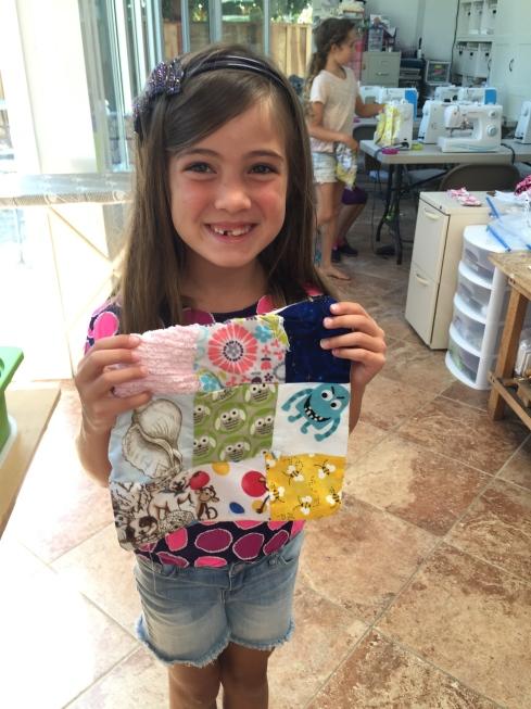 Her third quilt.